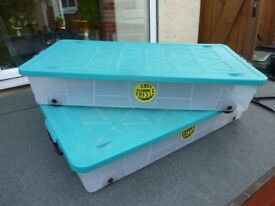 2x large under bed storage boxes.