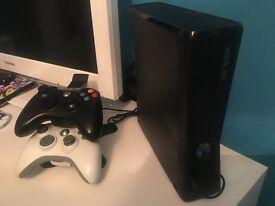 Black Xbox 360 and games and accessories