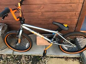 Orange and Silver BMX Bike been used once