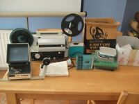 old cine projecter and screen and splicer and editer