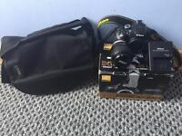 Nikon D5300 DSLR Camera with Lens boxed and a bag