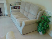 3 seater material sofa, just 1 year old, needs to go before 30 Nov! Excellent condition.
