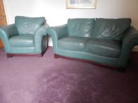 Green leather sofa and armchair.