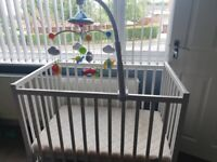 Space saver cot and mobile