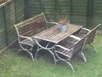 Cast iron table with bench and 2 chairs.