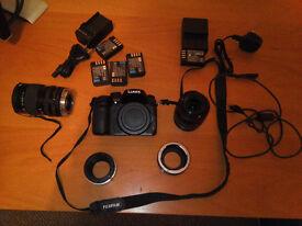 Panasonic GH4, 2 lenses, 5 batteries and Nikon and Canon adapter