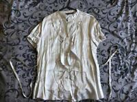 Silver ruffled satin blouse.