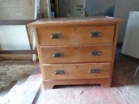 wooden chest of drawers......scratched on top ...all drawers work 3ft high X3ft wide (approx )
