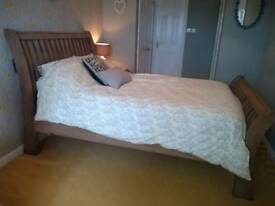 Large recycled wooden framed double bed