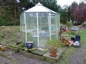 FREE - 6 sided aluminium frame greenhouse (all glass) with shelves and sliding door