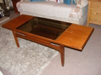 Vintage G-plan coffee table with glass insert and wood undershelf.