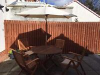 Garden table, chairs and umbrella