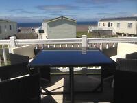 Craig Tara Platinum 3 Bedroom Caravan for Hire with Patio Doors, Deck and Sea Views