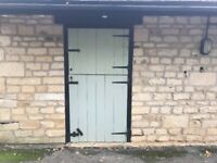 Three sets of stable tongued and grooved doors with frames.