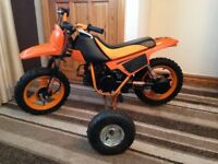 training wheels for a kids motorbike where fitted to a pw50 used once will fit other bikes only £45