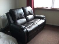 Two seater dual recliner