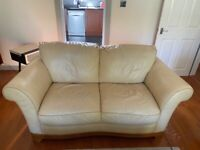 White 2 seater leather sofa in good condition