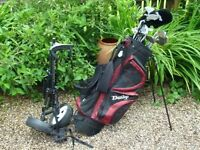 Golf Bag, Trolley, and 14 Clubs. Woods (1, 3, and5), Irons (1, 3, 5, 6, 8, + High Lob, MS, PW)