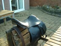 Black leather jumping saddle with bridle