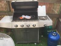 Gas BBQ with stove and gas bottles