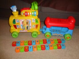 Vtech Push and Ride Alphabet Train complete with all 26 letter and picture alphabet blocks