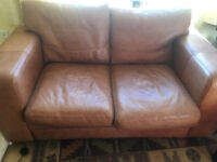 Brown leather two seater settee. 2 seater sofa couch