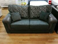 Stunning fabric and faux leather 2 seater sofa with leaf design and cushions