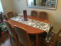 Oval wooden extending dining table and 6 chairs