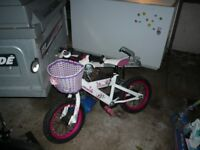 White and Pink Bike with basket in great condition - suitable for girl aged 4 - 7