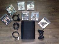 Sony PlayStation 3 super slim 500GB and 7 games.