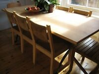 Quality eight place dining table in light wood with hammered steel cross brace legs and 9 chairs