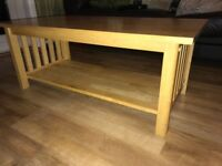 Solid wood coffee table with shelf