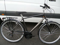 Raleigh Pioneer 1 Mens Brand New Traditional Hybrid Comfort Town Bike Rack Mudga