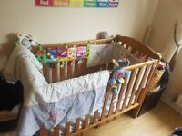 Wooden Baby cot - very good with many extras