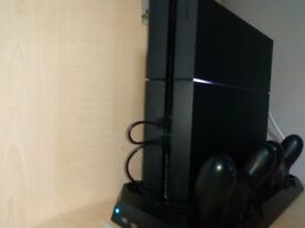 PS4 with a controllers and games