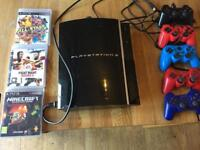 Playstation 3 with controllers and 3 games