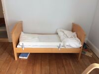 Wooden child's bed/cot