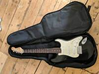 Fender Squire Stratocaster guitar with case and strap