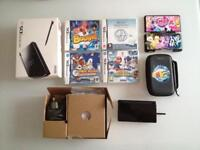 Nintendo ds lite gloss black + 4 games, cases, charger, manuals Boxed