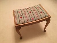 Vintage solid wood stool with hand embroidered seat. Excellent condition.