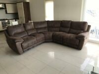 Immaculate leather look microfibre reclining corner sofa