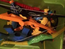 Plastic toy guns, bows and arrows etc