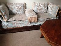 Two Moroccan style sofas with matching table