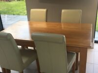 Solid oak dining table and 4 oak chairs