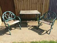 Unique cast iron garden table and chairs
