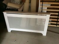 As new. White radiator cover