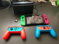 Nintendo Switch bundle with MARIO CART DELUXE 8 and extra joy cons