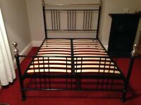 "Black metal double bed frame - 4' 6""."