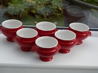A set of 6 red French soup bowls