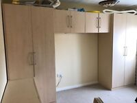 Wardrobe set including drawers
